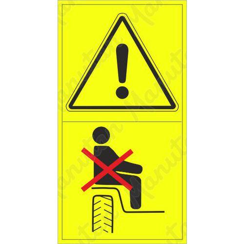 Figyelmeztető táblák - Működés közben ne szállítson személyeket a gép ezen részén